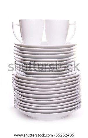 a stack of white dishes and cups isolated on white