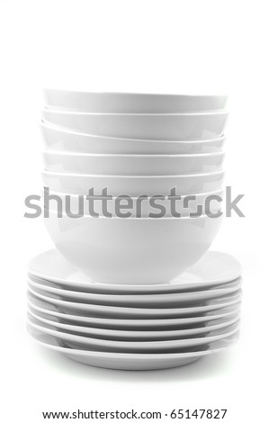 a stack of white dishes en soup bowls isolated on white