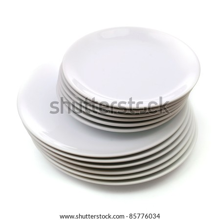 a stack of white dishes isolated on white