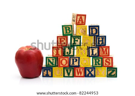 A stack to color wooden blocks of the alphabet with an apple isolated over white, Schools Days