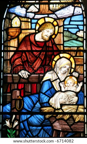 A stained glass window of Mary, Joseph and baby Jesus.