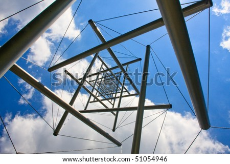 A stainless steel and cable tower structured photographer from below