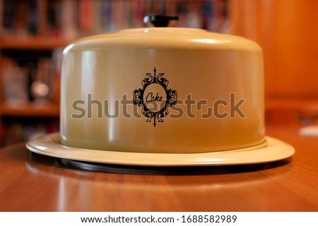 a Stainless Steel Cake Tin with Cover Lid and Round Handle Сток-фото ©