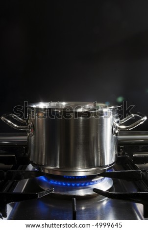 A stainless steel pan on a stove - stock photo