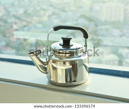 A stainless steel tea kettle .