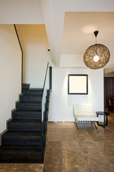 A staircase and entry way in a beautiful home interior.