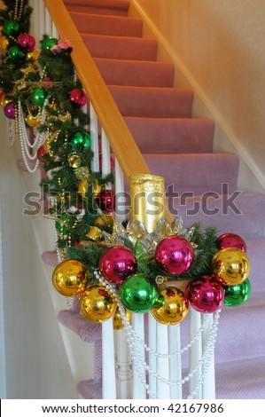 A Staircase Decorated In Colored Balls For The Christmas Season ...