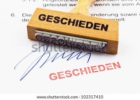 a stamp made of wood lying on a document. german inscription divorced