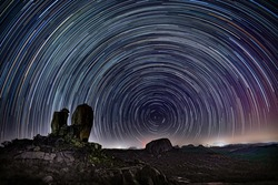 A star trail photo taken at a remote location with Polaris as the center star
