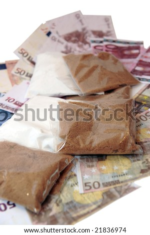 a stash of drugs and money showing a high cost to life against a white background