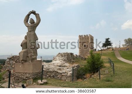 A statue and a tower, Skopje castle, FYROM Zdjęcia stock ©