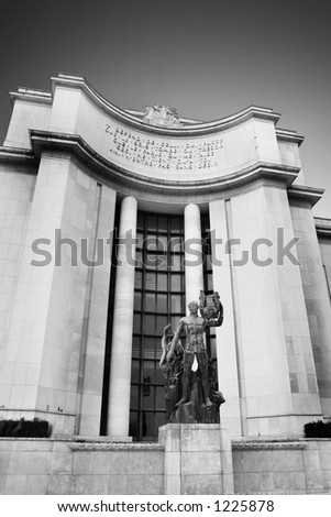 A statue in front of a old building in Paris, France. Black and white.   Copy space. - stock photo