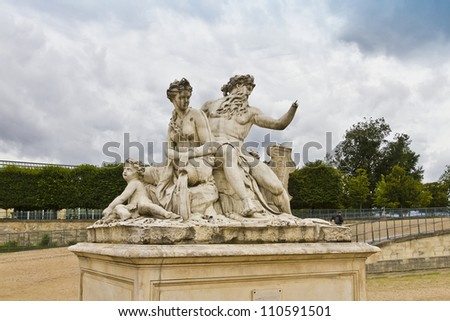 A statue in Jardin des Tuileries. Tuileries Garden (Jardin des Tuileries) - public garden located between Louvre and Concorde Place. It was opened in 1667. Paris, France - stock photo