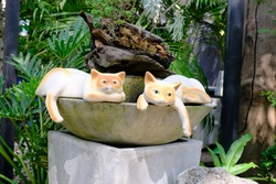 A statue of a cat on a bath.