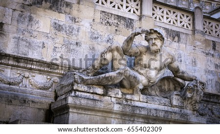 A statue of a fountain of The Altare della Patria (Altar of the Fatherland) in Rome, Italy