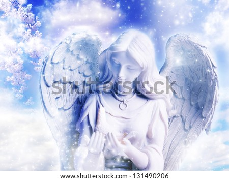 a statue of angel over a spring background