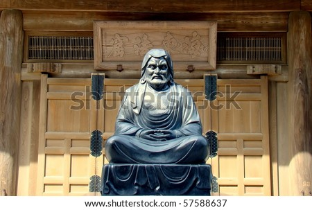 A statue of Bodhidharma, a Buddhist monk traditionally credited as the transmitter of Zen to China. Picture taken at the Temple Kencho-ji in Kamakura, Japan. - stock photo