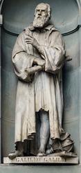 A statue of Galileo Galilei sitting outside of the Uffizi, in Florence