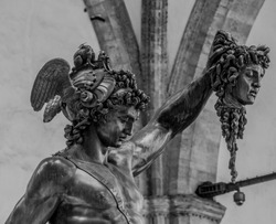 A statue of Perseus holding Medusa's head.
