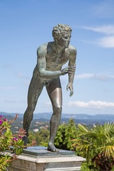 A statue of 'The Runner' in the garden of Achilleion in Corfu palace.