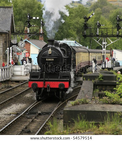 a steam train leaving grosmont station