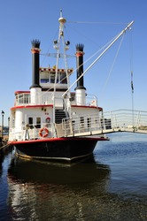 A stearn-wheeled paddle boat offers cruises of the Inner Harbor, Baltimore, MD