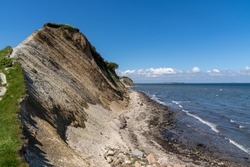 a steep hiking trail leads up to jagged cliffs on the shores of the Limfjord in northern Denmark