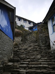 a steep step of the stone stair in the village.