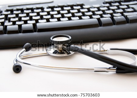 A stethoscope and computer keyboard - stock photo