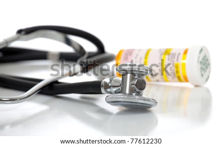 A stethoscope and prescription bottle on a white background with copy space
