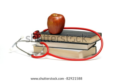 A stethoscope, book, and apple represent a well knowledged healthcare professional.