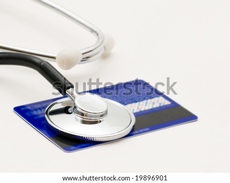 A stethoscope by a Credit card payment