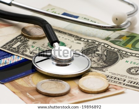 A stethoscope by  money and credit card