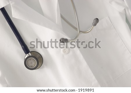 A stethoscope draped over a doctor's lab coat