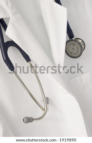 A stethoscope drapes over a doctor's labcoat