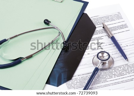a stethoscope on a medical billing statement