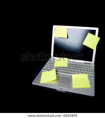 A sticky note on a laptop computer - remember this