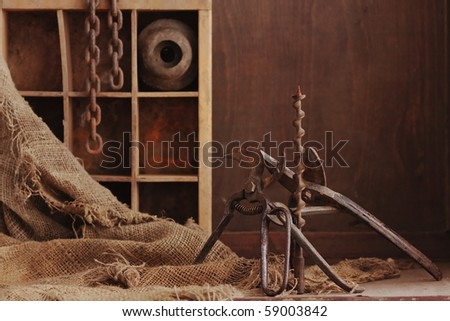 a still life composition with old dusty objects on wood background, empty space for text