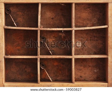 a still life composition with old dusty shelves with three keys and a rusty chain