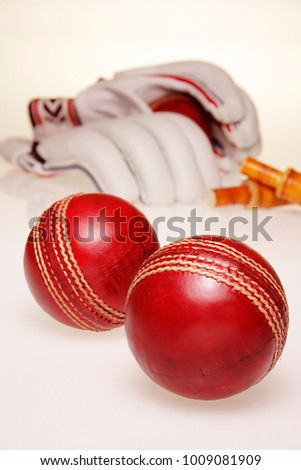 Stock Photo A STILL LIFE OF CRICKET BALLS ON A PLAIN BACKGROUND