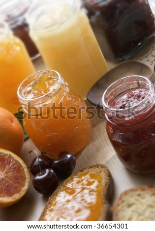 A still life of fruit jam on a table
