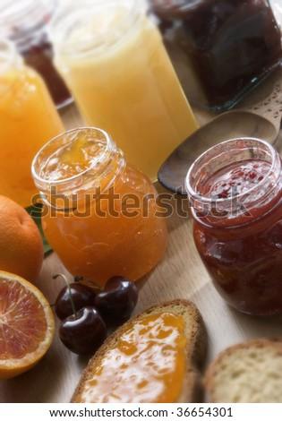 A still life of fruit jam on a table