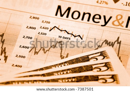 a stock market chart with some bills