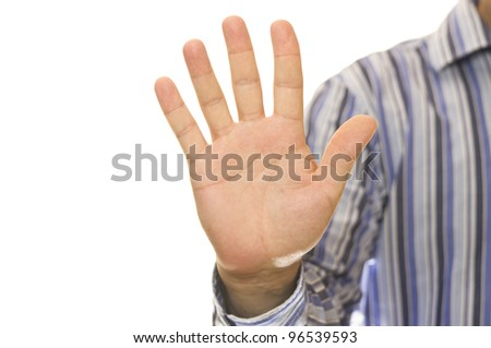 A stock photo of a man in a casual striped shirt showing his hand as if for a palm print