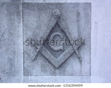 A stone carving of the mason's symbol on an old masonic temple in the Pacific Northwest