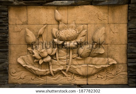 A stone inscription of a flower, Thai style of buddhism