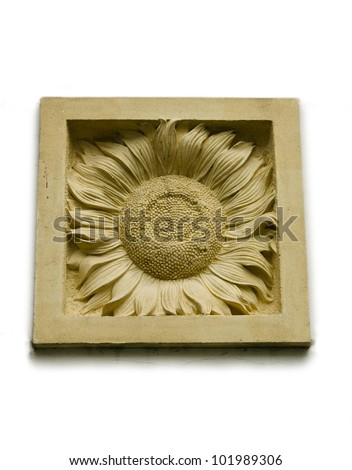 A stone inscription of a Sunflower
