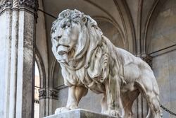 A stone lion sculpture at the Feldherrenhalle in Munich, Germany
