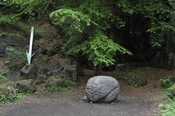 A stone memorial that looks like a human brain in the forest
