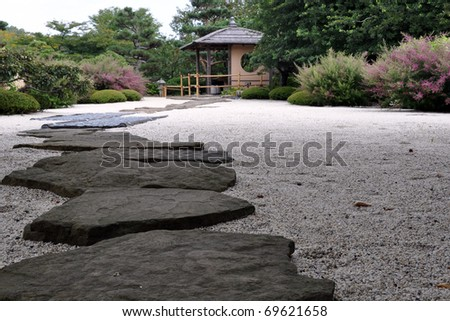 A stone path in a Japanese garden